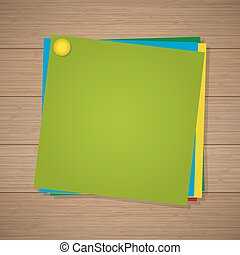 Colored paper for notes with a pin attached on the wooden background