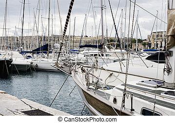 Yachts moored at Msida Marina in Malta. Sail boats in a row...