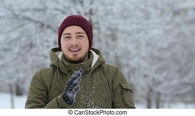 Happy man snow ball headshot, slomotion - Happy man snow...