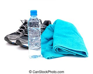 Health And Fitness - A bottle of water, joggers and a sports...