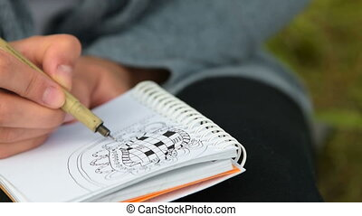 Drawing is her hobby - Close-up shot of woman making sketch...