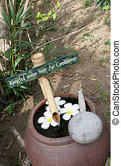 Recycled water container for washing feet. Thailand travel...