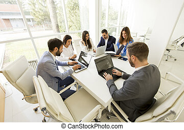Teambuilding - Young business people having meeting in...