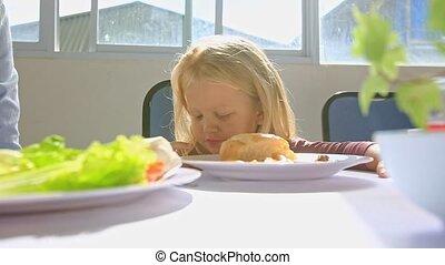 Little Blond Girl Talks at Breakfast Moves Aside Plate on...
