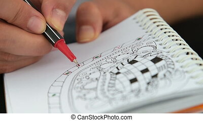 Woman spending time with relax drawing - Close-up shot of a...