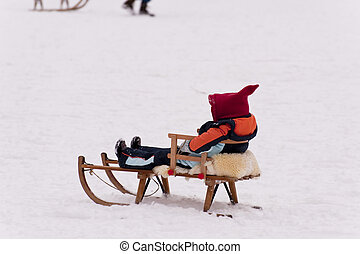 sledding in a snow covered landscape