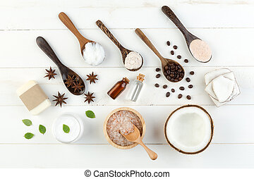 Homemade coconut products on white wooden table background....
