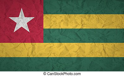 Togo flag with the effect of crumpled paper and grunge