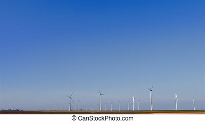 Ultra wide shot sky and wind turbines - Ultra wide shot of...