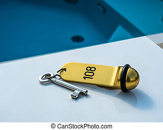 hotel key with pool - a hotel key on a table next to dempool