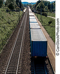 freight train on the railway track - a train carrying goods...