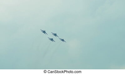 Aerobatics of four jet fighters - Group of four fighters...