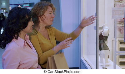 Woman points her hand on store window - Attractive caucasian...