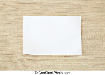white blank paper on wood