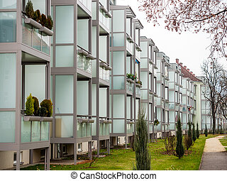 in older residential buildings balconies were grown - in...