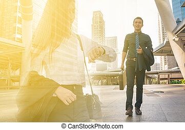 Double Exposure of Young Adult Businessman Walking with...
