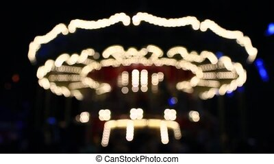 blurred carousel in the New Year holidays - beautiful...