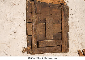 Old wooden window of an house in a warehouse - Old wooden...