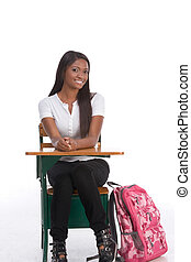 African American College student by school desk - education...