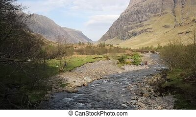 Glencoe river Clachaig Scotland UK with mountains in...