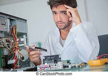Anguished man with dismantled computer