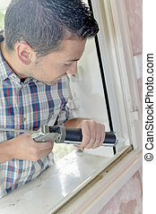 glazier working on a window
