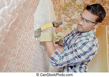 Chiseling a wall