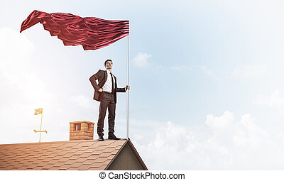 Young businessman with flag presenting concept of...