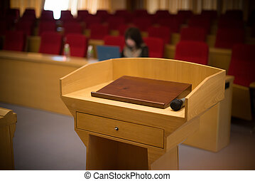 rostrum with a microphone in a reference room with one...