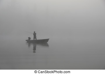 early morning fishing in the fog - Picture of a fisherman...
