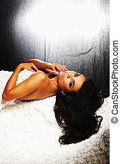 brunet sexy girl laying down on sofa - A brunet sexy girl...