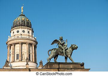Statue and french dome at Gendarmenmarkt, historic Berlin -...