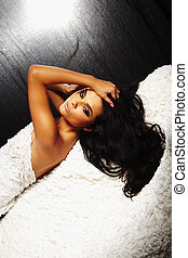 brunet sexy girl laying down on sofa