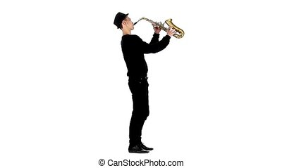 Saxophonist plays a musical instrument. White studio. Slow...