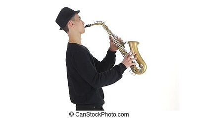Slow motion. Saxophonist plays a tune on the sax -...