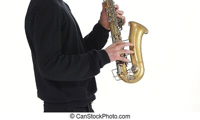 Solo saxophone. Playing young musician man in a slow motion...