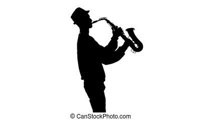Silhouette jazzman performs solo on saxophone in a slow...