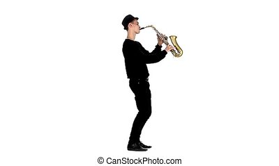 Slow motion. Saxophonist plays a musical instrument. White...
