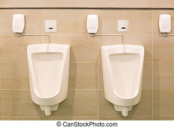Urinal Men Toilet - White automatic urinal for men on tile...