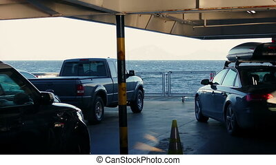 Cars On Ferry Deck Crossing Water - Vehicles on deck of ship...