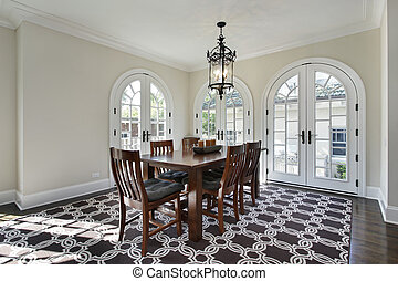 Dining room with circular doors - Dining room in luxury home...