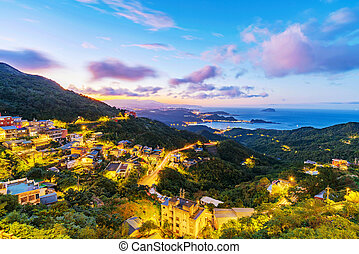 View of Jiufen town in the evening - Scenic view of Jiufen...