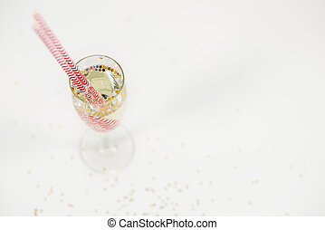 Close up of champagne glass with straws