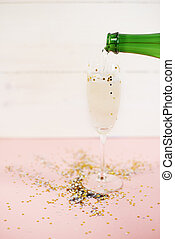 Pouring splendid champagne to the glass