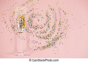 Abstract picture of drinking glass and confetti