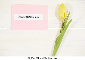 Yellow tulip next to Mothers Day card