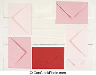 Directly above shot of five red envelopes