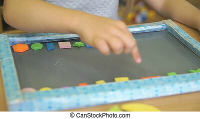 Pupil learning counting with colors and shapes - Hands of...