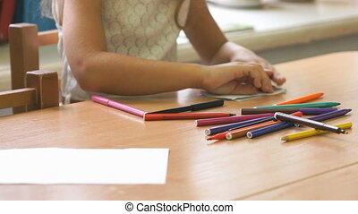 Teenager draws the picture using the felt pens - Teenager...
