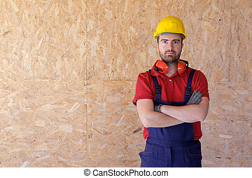 Portrait of a carpenter with wooden thermal insulation material